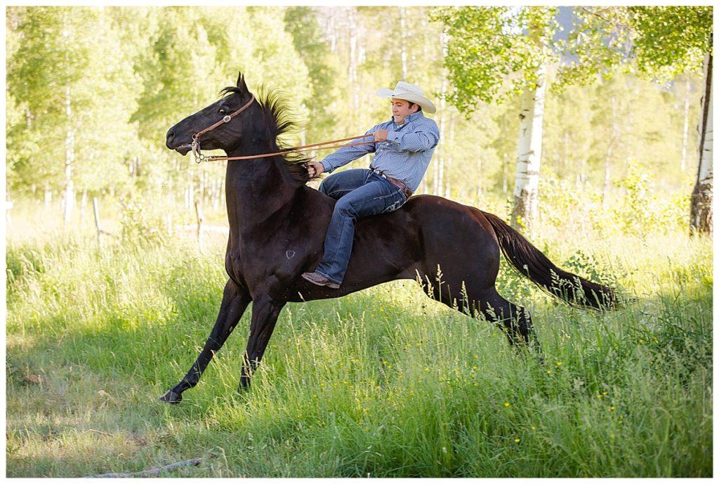 horse jumping cowboy